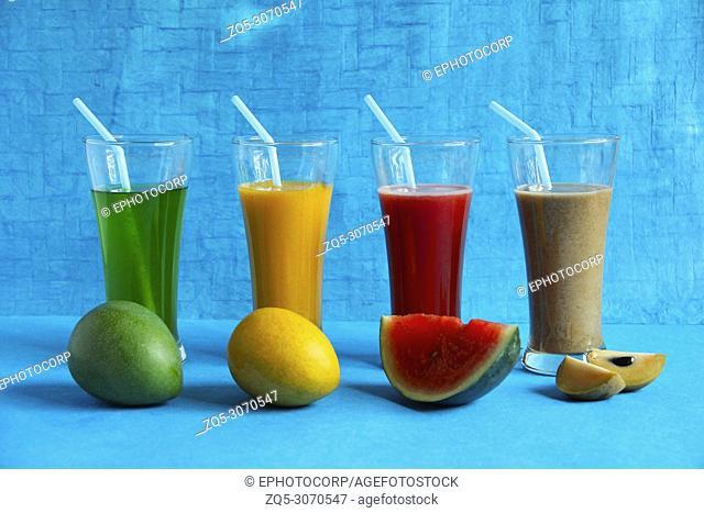 Fruits like raw alphonso mango, ripe alphonso mango, watermelon, chikoo or sapota and their juices