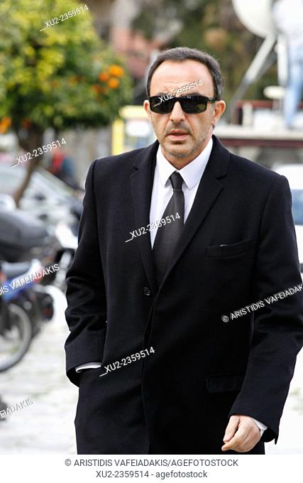 Nikos Aliagas arrives for the funeral. Greek singer Demis Roussos, best known for his hit operatic pop ballads in the 1970s and 1980s, has died aged 68
