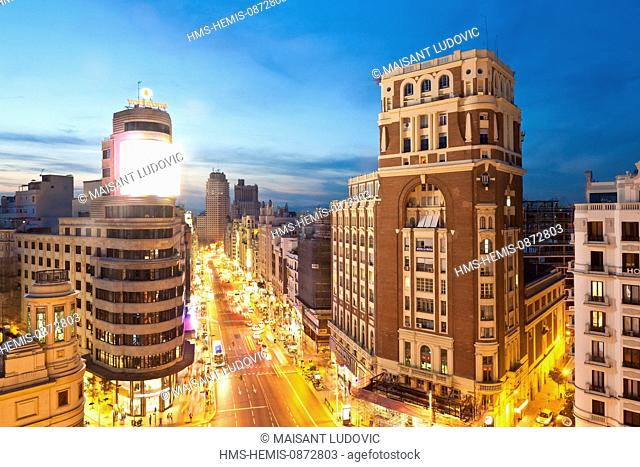 Spain, Madrid, Gran Via view with Carrion edifice on left designed by architects Luis Martinez-Vicente and Feduchi Eced y Eced in the 1930s and on right the...