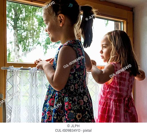 Girls looking out of window
