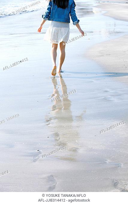 Attractive young Japanese woman by the sea