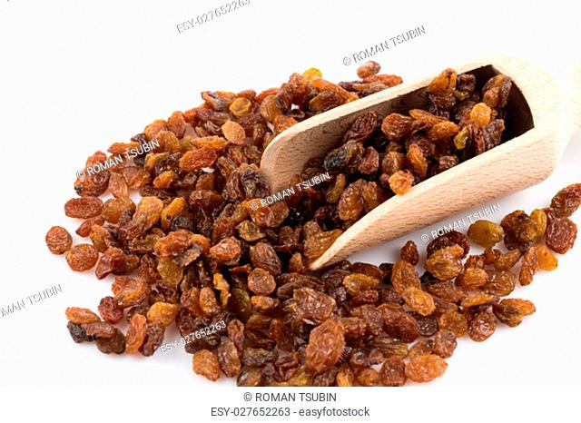 Sweet dry raisins in scoop isolated on the white background