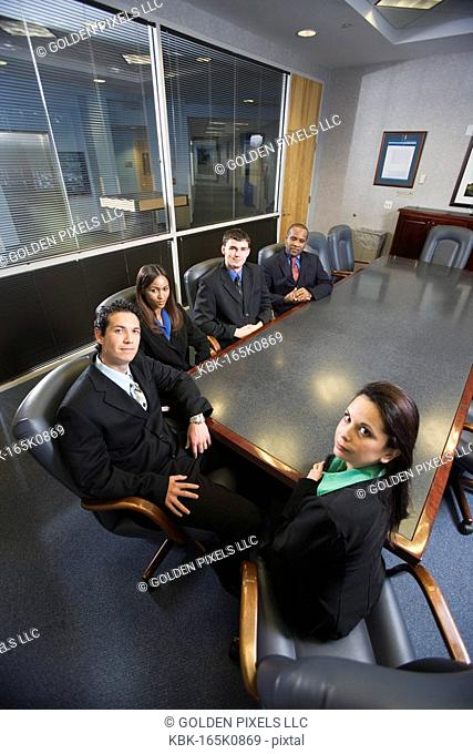 Portrait of business executives in a formal conference room
