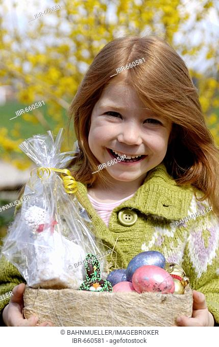 Child with her easter eggs net basket