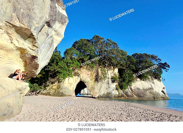 Young couple visit in Te Whanganui-A-Hei (Cathedral Cove) Marine Reserve in Coromandel Peninsula North Island, New Zealand