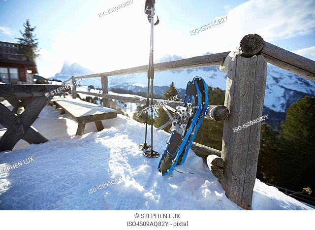 Ski poles and snowshoes outside mountain restaurant, Dolomites, Eisack Valley, South Tyrol, Italy