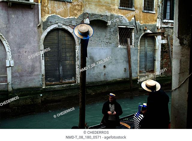 High angle view of two gondoliers, Venice, Veneto, Italy
