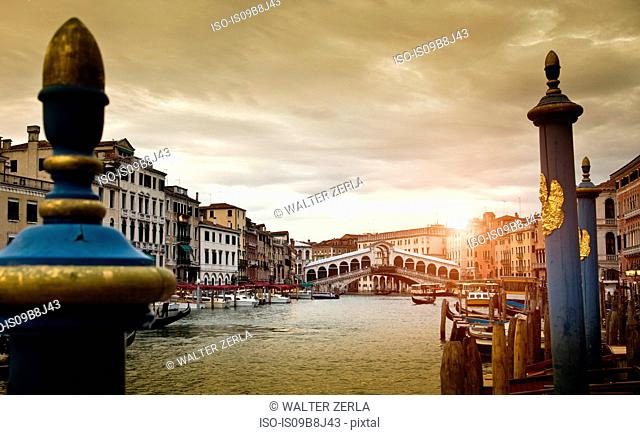 Boats on canal at sunset, Venice, Veneto, Italy, Europe