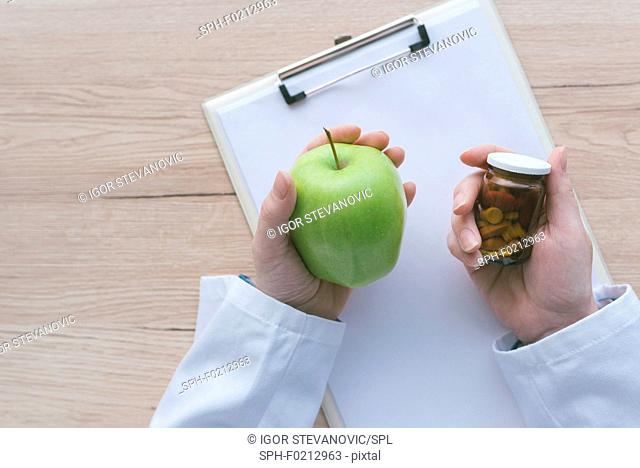 Doctor advising apple instead of pills