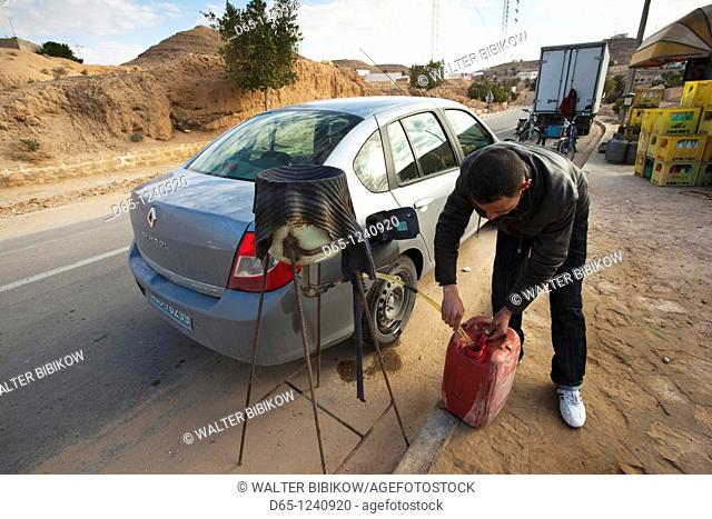 Tunisia, Ksour Area, Matmata, Berber filling station, petrol sold by the roadside out of cans, NR