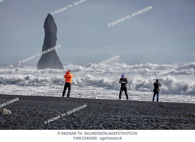 Basalt Sea Stack and waves at Reynisfjara Beach located by Vik in Myrdal, South Coast of Iceland. Icelandic folklore states that these stacks are thought to be...