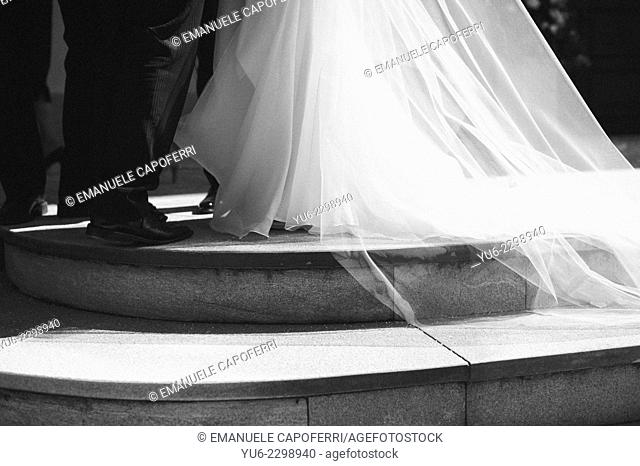 Bride out of the church as she greets the guests