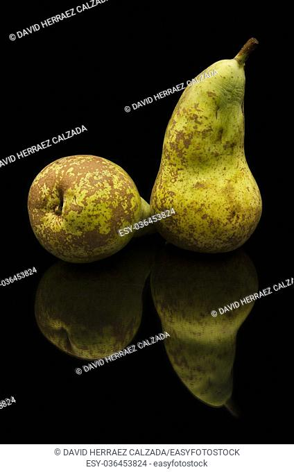 Brown pears on black isolated background