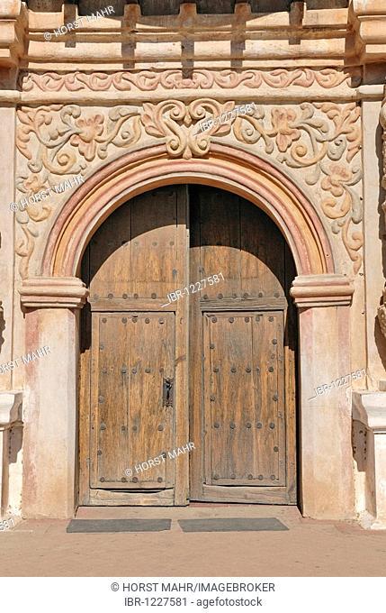 Baroque sandstone portal of Mission San Xavier del Bac, also known as white dove of the desert, south of Tucson, Arizona, USA
