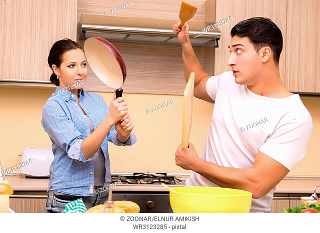 Young family doing funny fight at kitchen