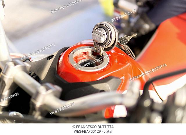 Open filler cap of a motorbike
