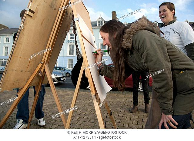 Aberystwyth University students open air art project event on the promenade, Wales UK