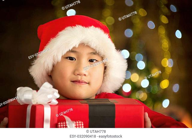 Children are a gift received from Santa Cross. - Christmas day concept. Soft focus
