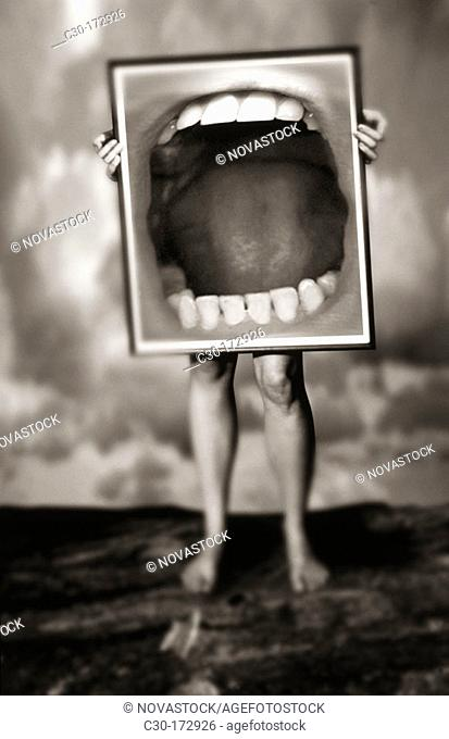 Man holds sign of open mouth