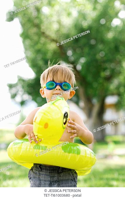 Boy(2-3) with inflatable ring-turtle