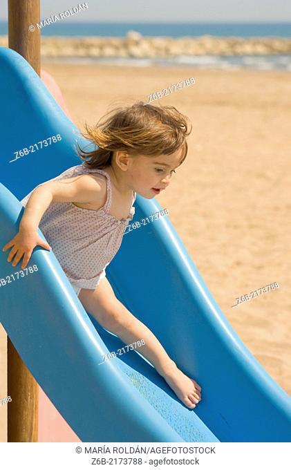 Baby girl, 18/19 months, Beach, Mediterranean sea, Valencia, Spain, Toboggan, Slide, barefoot, sand, wind