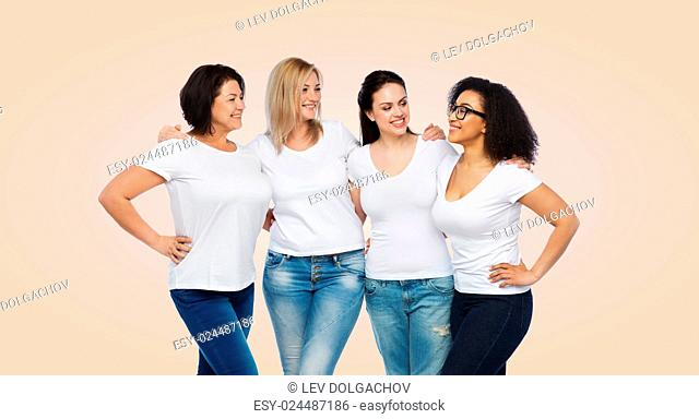 friendship, diverse, body positive, communication and people concept - group of happy different size women in white t-shirts hugging and talking over beige...