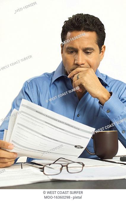 Man Reading a Tax Form