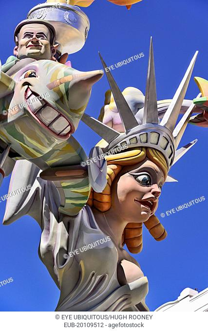 Papier Mache figure of a woman resembling the Statue of Liberty with another figure flying around her during Las Fallas festival