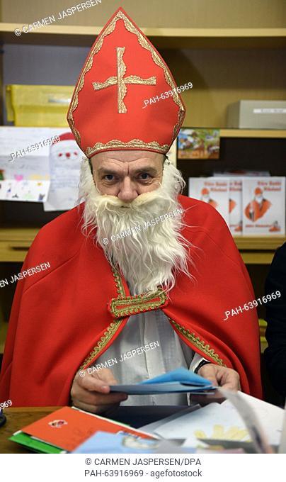'Santa Claus' Hubert Wendehage responds to letters in the Santa Claus office in Nikolausdorf (lit. Nicholas village), Germany, 24 November 2015
