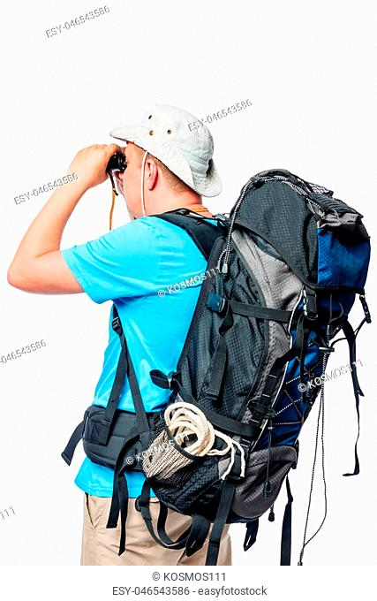 Man with a backpack looking through binoculars on a white background