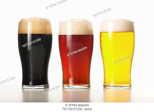 Three beers in glasses, studio shot