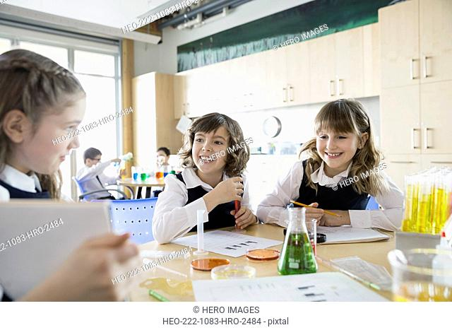 School girls conducting experiment in science classroom