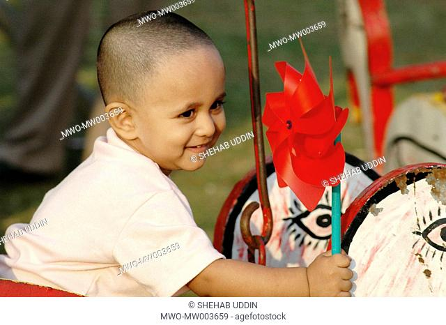 Children enjoying with toy at the Baishakhi Mela Bengali New Year fair in Dhaka on May 04, 20005 Millions of Bangladeshi people including men