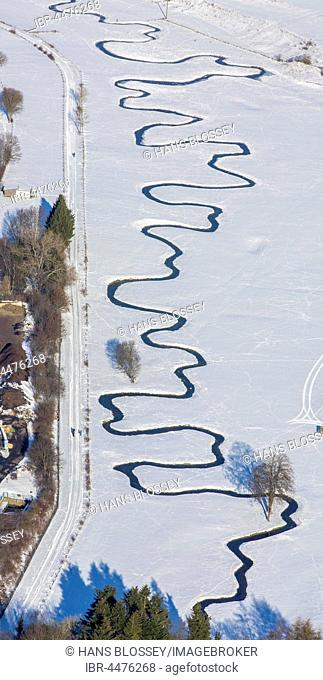 Meandering river Möhne in the snow, Hunderbecke, Brilon, Sauerland, North Rhine-Westphalia, Germany