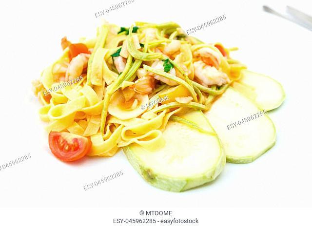 Tagliatelle with tiger prawns, tomatoes and zucchini