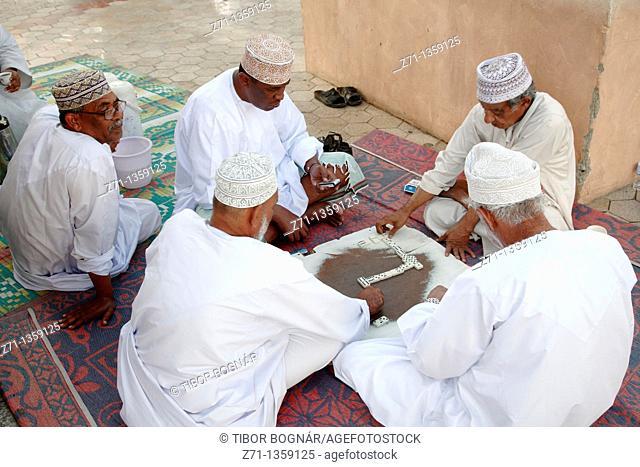 Oman, Muscat, Mutrah, men playing dominoes