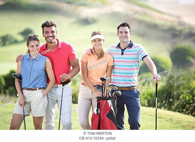 Friends smiling on golf course