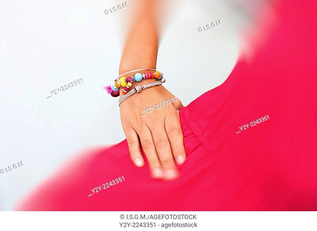 Woman in red with bracelets