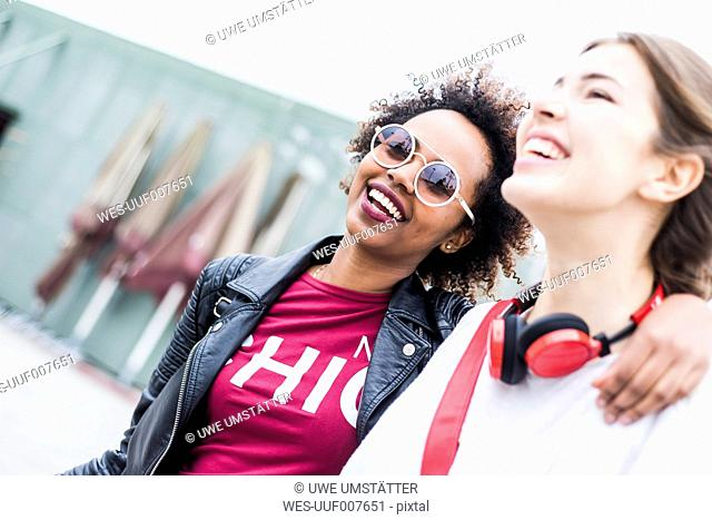 Portrait of happy young woman and her best friend