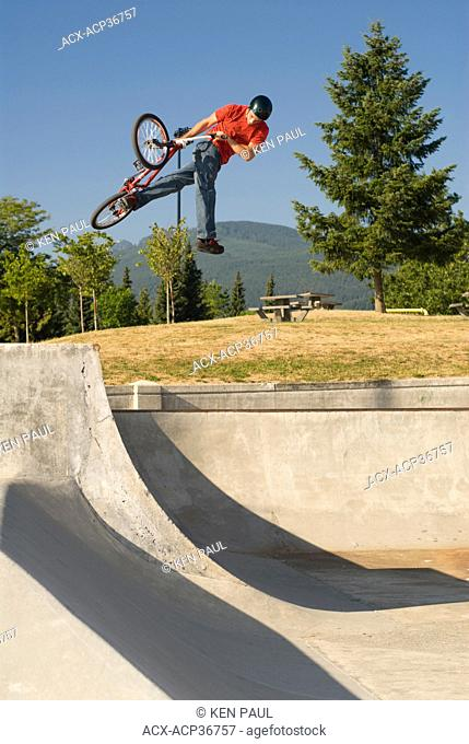 BMXer with a can-can air on the quarter at Lafarge Skatepark, Coquitlam, BC, Canada
