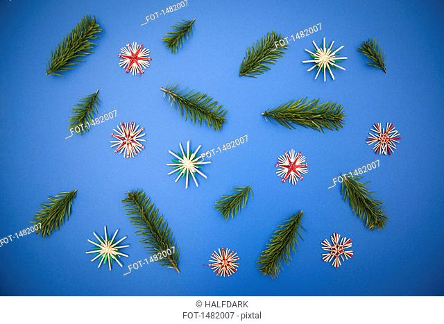 Directly above shot of Christmas decorations on blue background