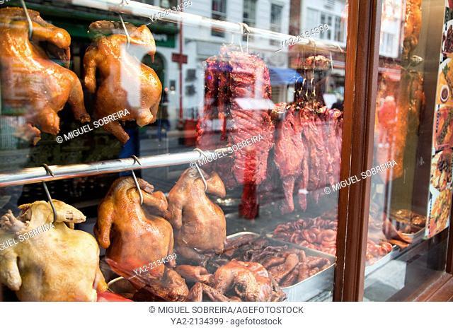 Crispy Ducks Hanging at Restaurant Windows in Chinatown, Soho London UK