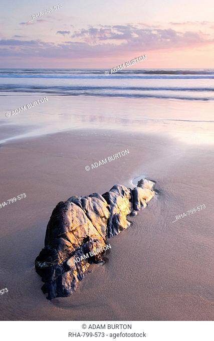 Rock and sand at sunset, Sandymouth Bay, Cornwall, England, United Kingdom, Europe