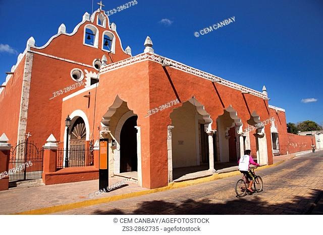 Cyclist in front of the Candelaria Church, building once functioned as a Franciscan Monastery, Valladolid, Yucatan Province, Mexico, Central America