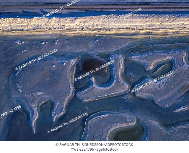 Top view of patterns on the beach, Eyjafjordur, Iceland. This image is shot using a drone