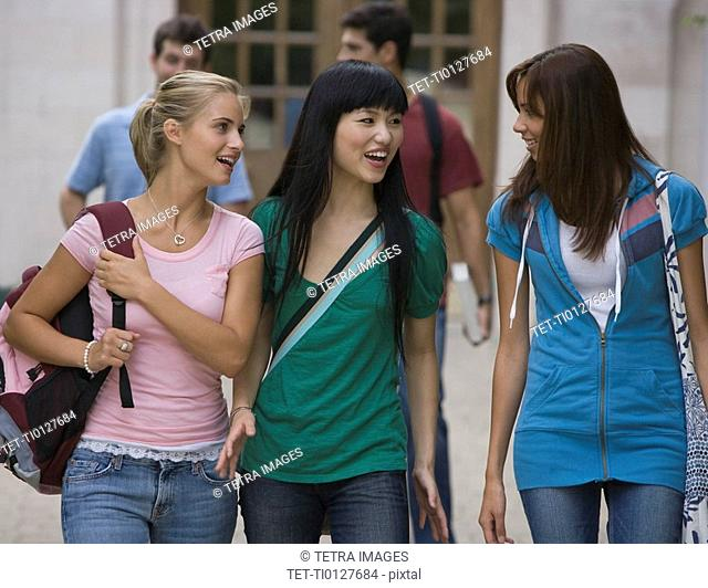 Group of female college students talking