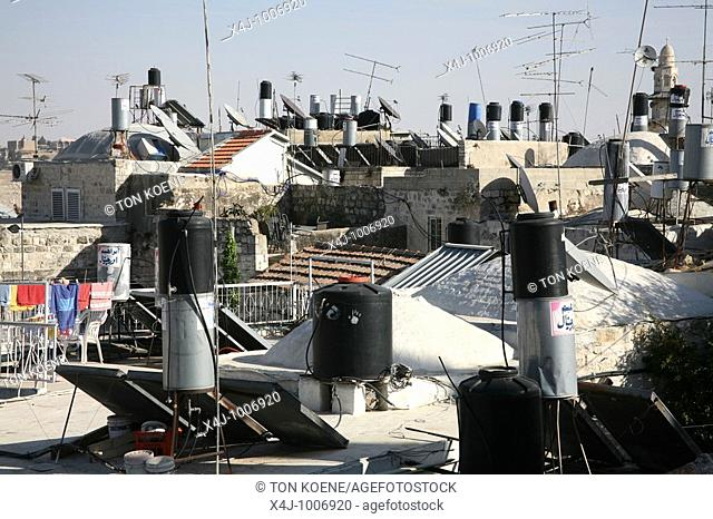 Rooftops full of chimneys and communications equipment in the old city section of Jerusalem