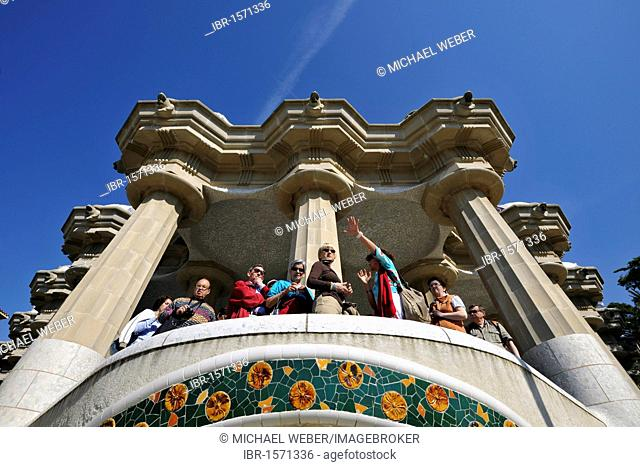 Tour group at the Park Gueell, Parc or Parque Gueell, Sala Hippostila, designed by Antoni Gaudí, UNESCO World Heritage Site, Barcelona, Catalonia, Spain, Europe