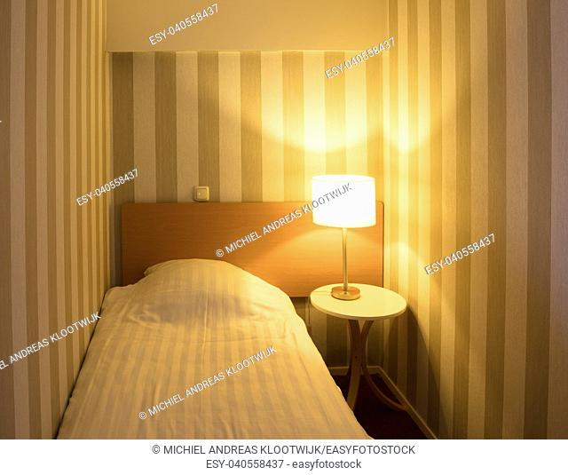 Simple small hotel room (classic), single bed
