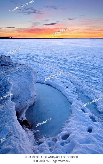 An evolving landscape of thawing and shifting ice graces Lake Simcoe in the early spring warmth. Georgina, Ontario, Canada